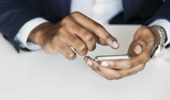 Closeup of businessman using mobile phone